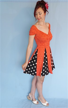 Cap sleeve sweetheart bodice with panel insert circle skirt.