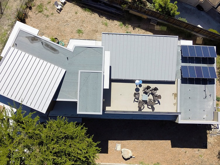 Warren ResidenceStanding seam metal roofing; Single-ply roofing; Hot mopped roof system; Lightweight concrete deck system