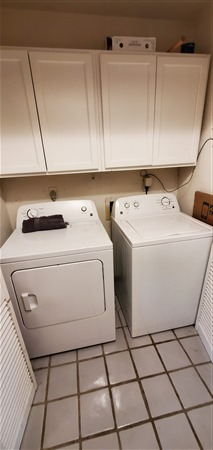 Full sized washer and dryer indoors