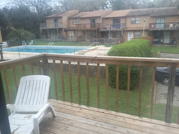 view of pool from back deck