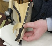 Step 26 Using flat head tacks, tack the hinge leather to the bellows base.