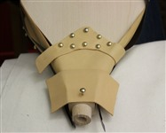 Step 31 Center the nose leather and tack it using a dome head tack