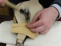 Step 30 Using dome head tacks, start tacking at the tip.