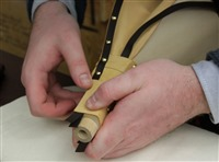 Step 36 Tack the edge of the nose leather over the edge tape – using dome head tacks.