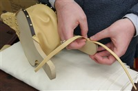 Step 39 Tack the 2 leather straps to the handle of the bellows back - using one dome head tack. Note the direction of the straps.